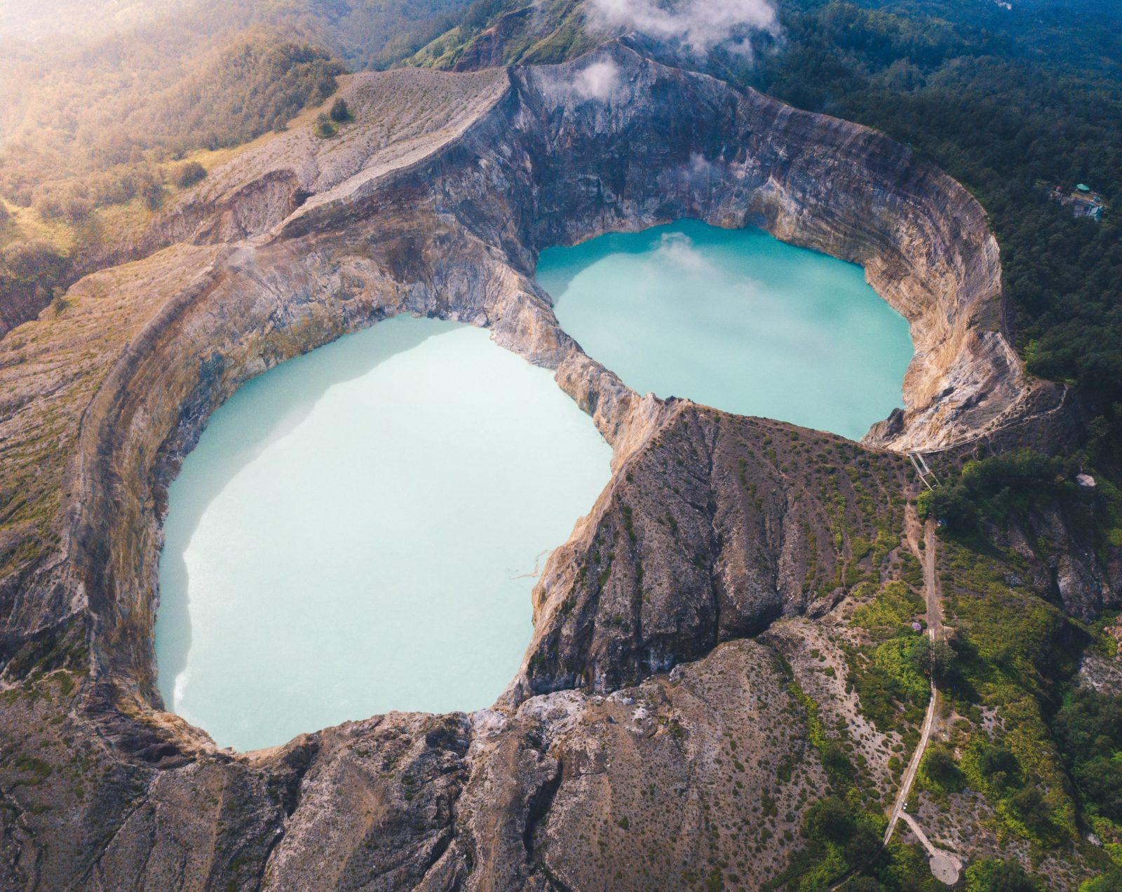 See the magical Kelimutu lake up in the mountain with Hello Flores