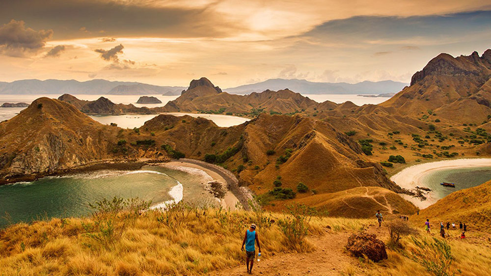 A group of people trekking in Padar island on the evening