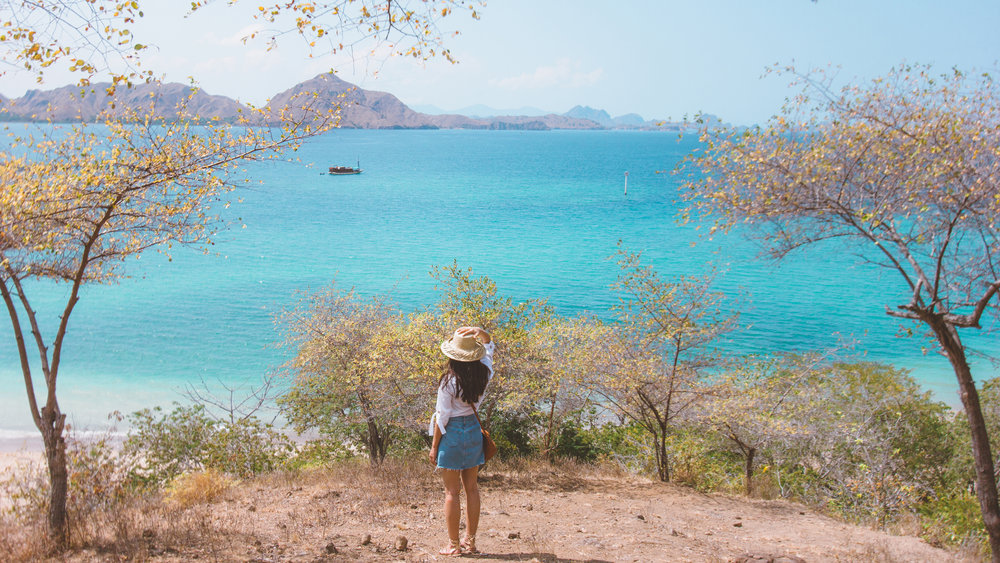 A woman enjoying the scenery of the ocean from Komodo Island