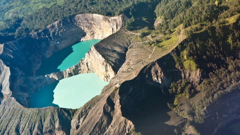 The lake in Kelimutu is located in the crater of its mountain