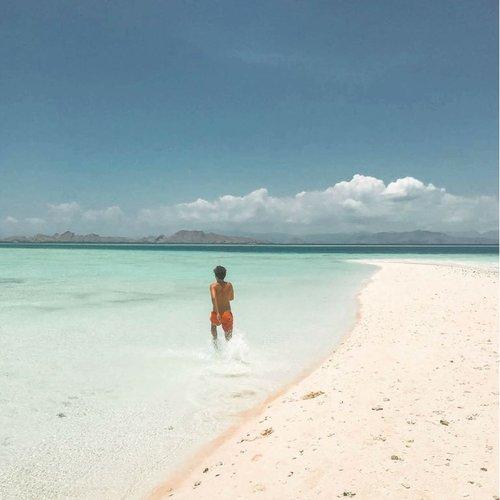 Feeling the water in Gili Lawa beach