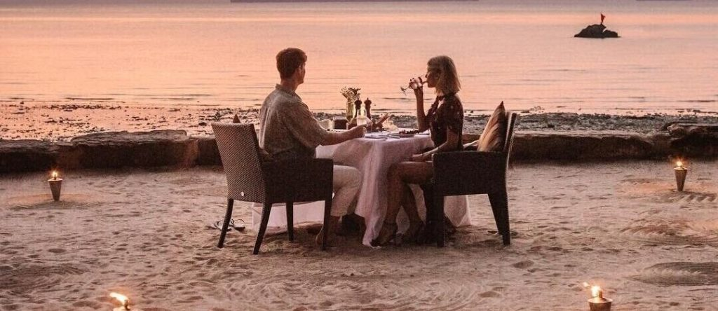 A couple is enjoying a romantic dinner on the evening