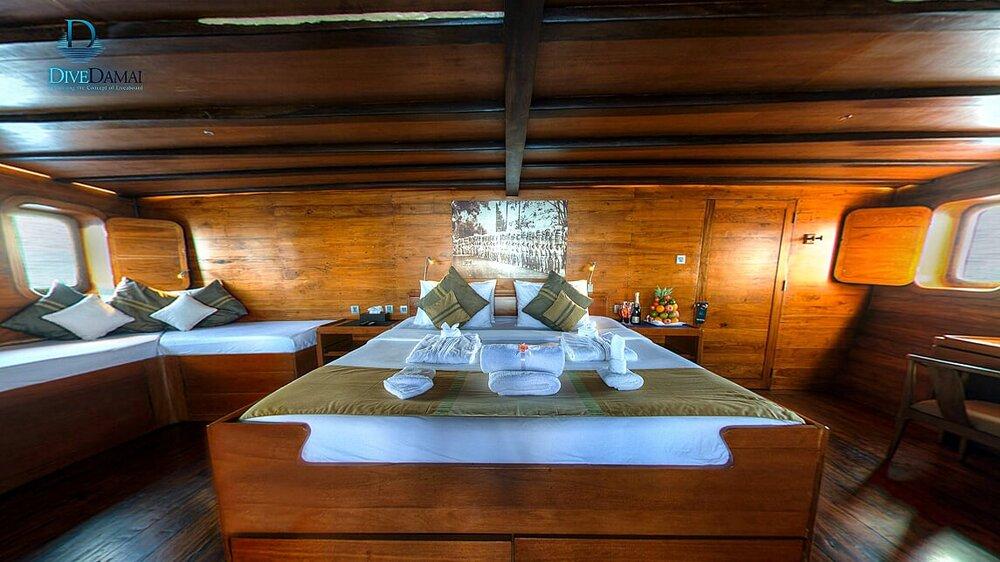 A nice main bedroom inside Damai II liveaboard | Hello Flores