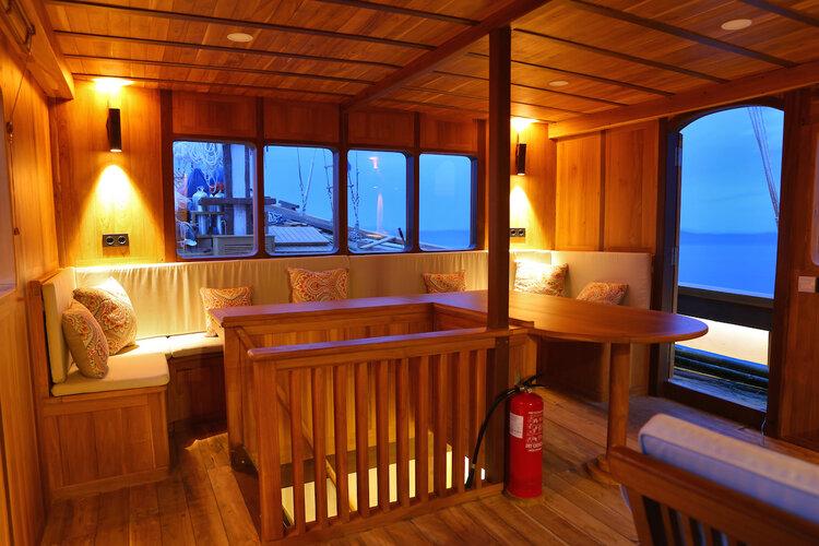 A comfy lounge inside Leyla liveaboard | Hello Flores
