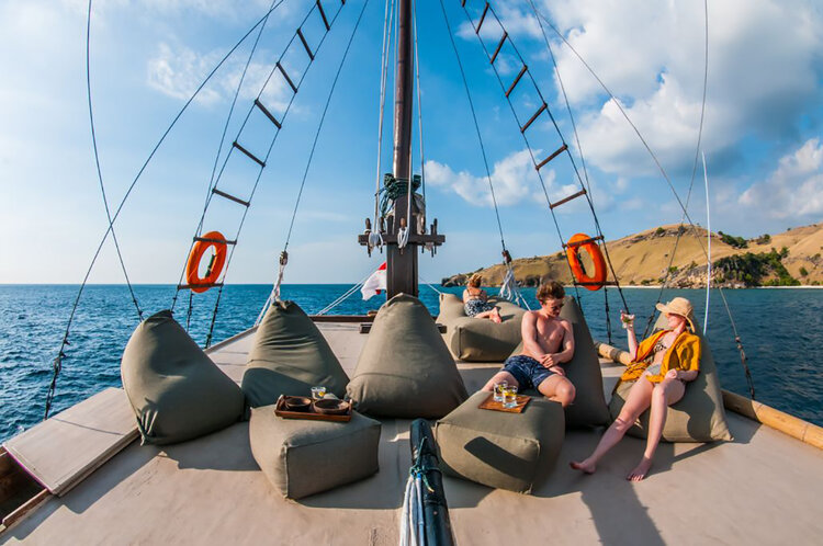 The guests are lazing around in the bean bags on Nataraja liveaboard