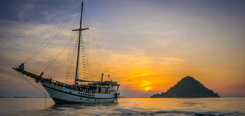 Wisesa Liveaboard Cruising Through Sunset | Hello Flores