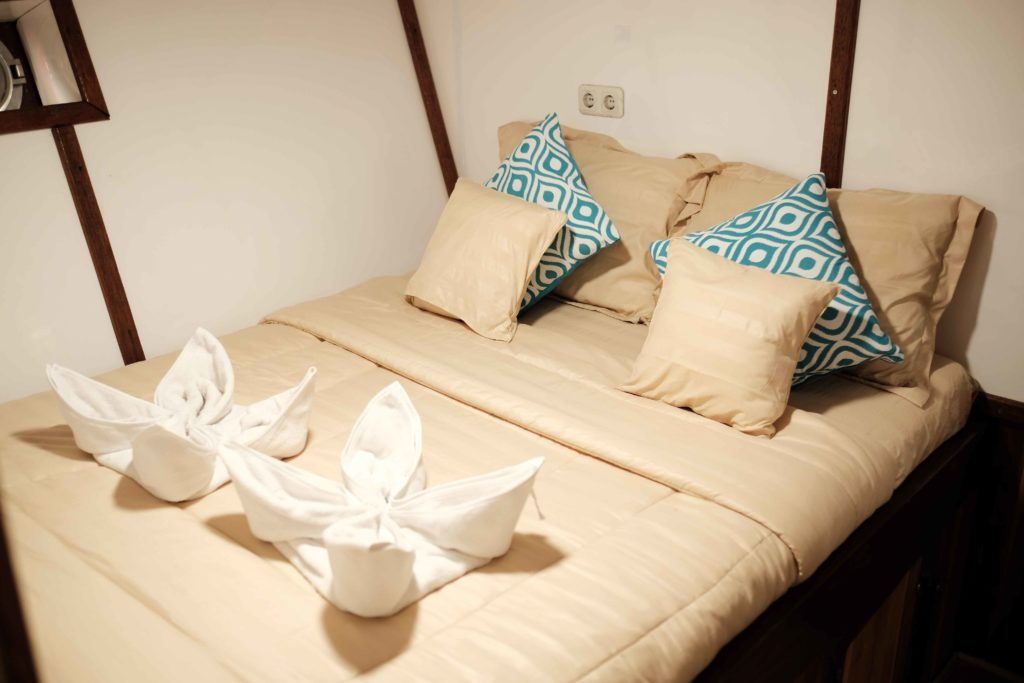 The main bedroom in SInar Pagi cabin with a large bed | Hello Flores