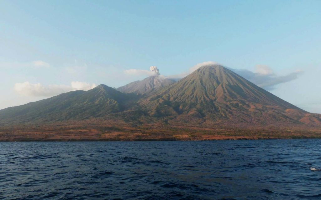 The volcanic Mount Sangeang in the middle of an island | Hello Flores