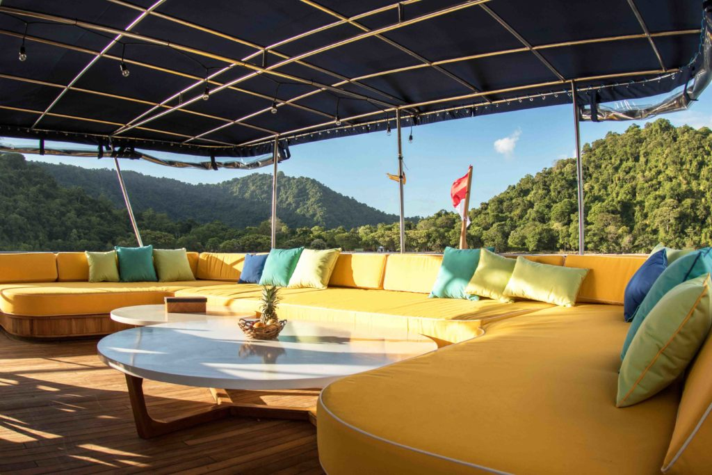 Outdoor lounge on the stern deck of Magia 2 liveaboard | Hello Flores