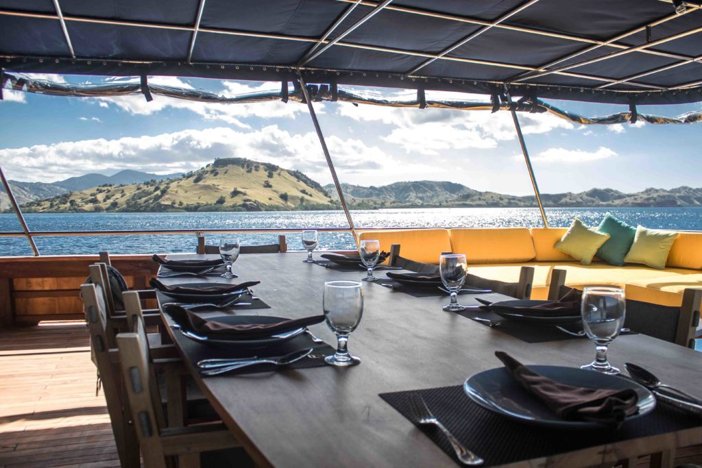 The outdoor dining area in Magia 2 liveaboard | Hello Flores