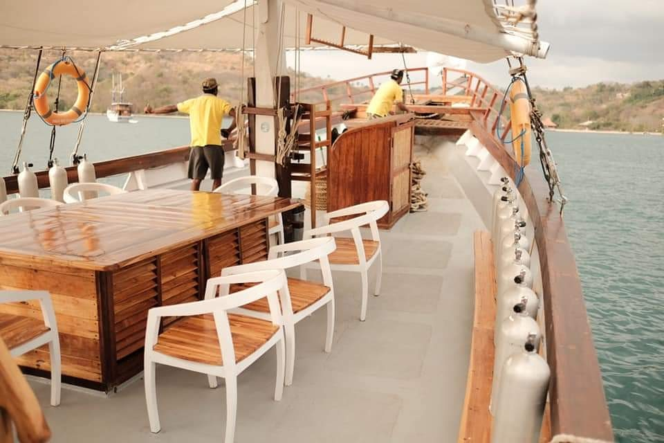 The dining area for guests onboard Sinar Pagi | Hello Flores