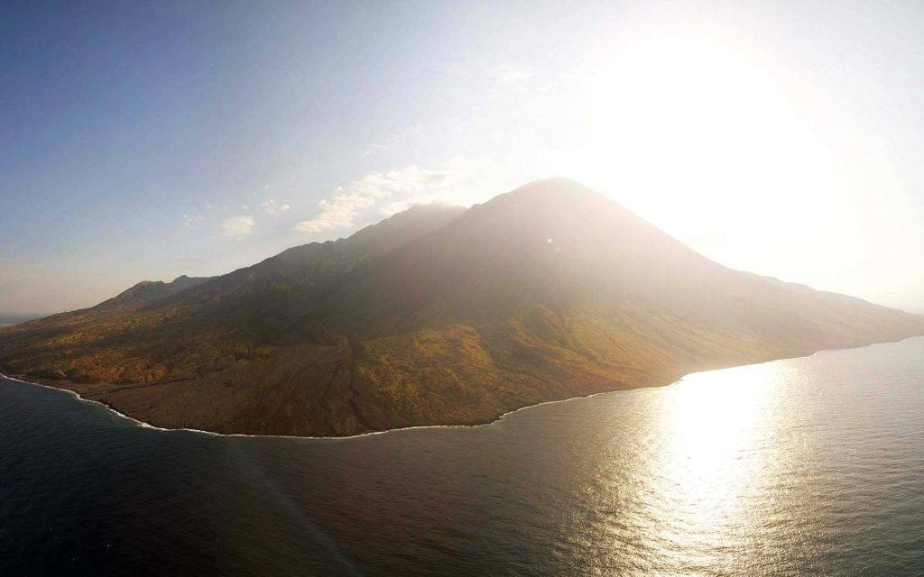 The beautiful sunset in Mount Sangeang viewed from the boat | Hello Flores