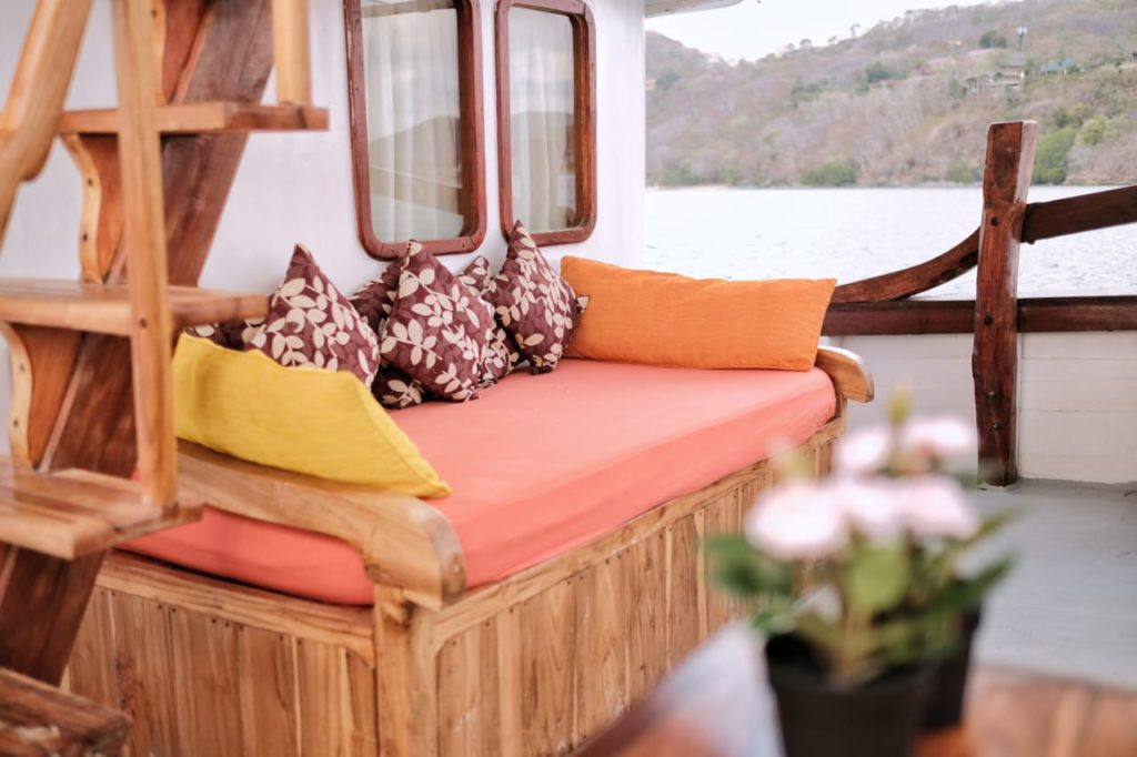 A comfortable couch on the SInar Pagi deck | Hello Flores