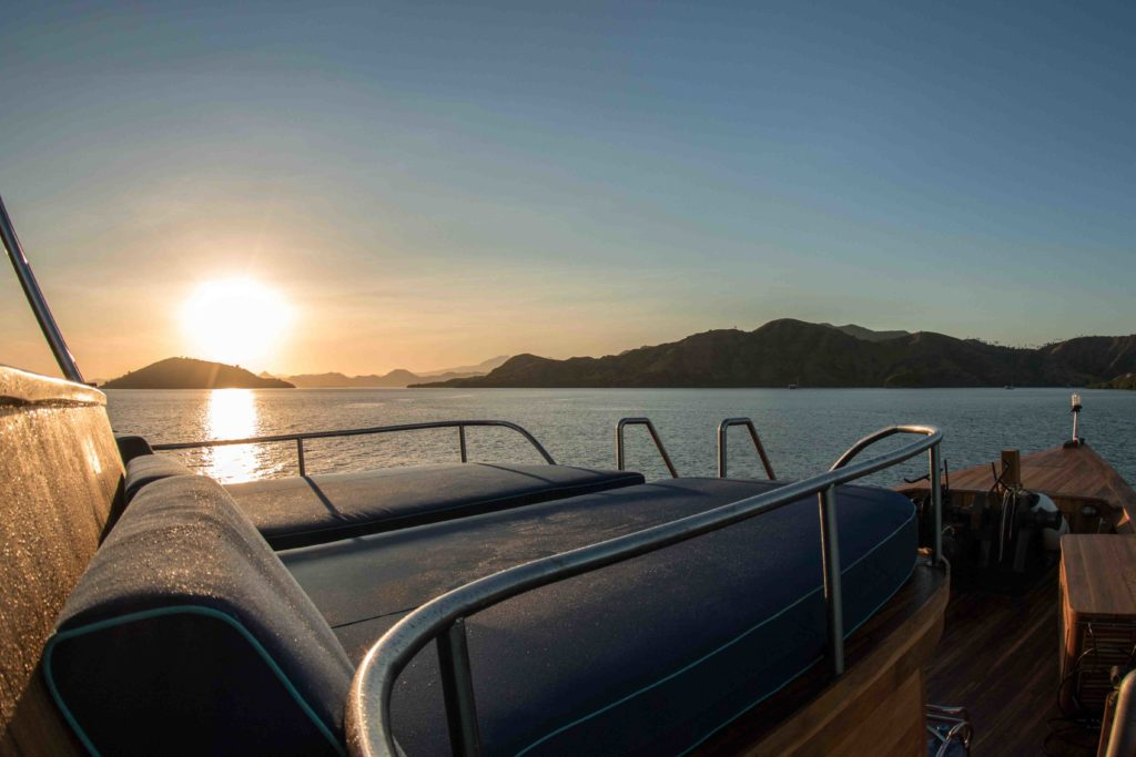 The sunrise seen from Magia 2 liveaboard upper deck | Hello Flores